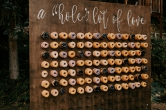 "a ""Hole Lot Of Love"" donut wall"